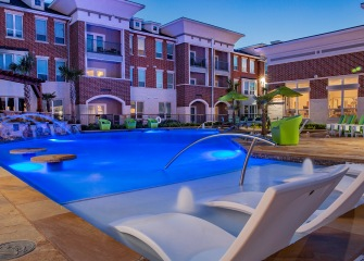 The Julian at South Pointe pool with fountains and lounge chairs